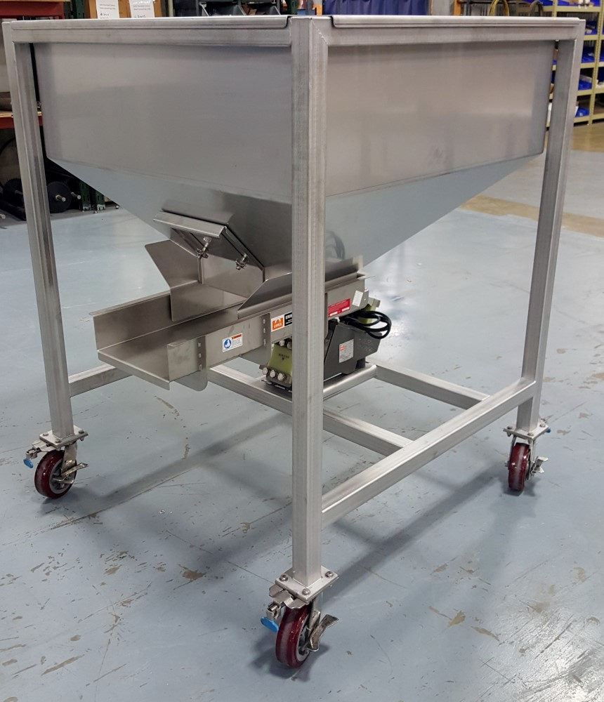 Stainless steel hopper with electromagnetic feeder on casters